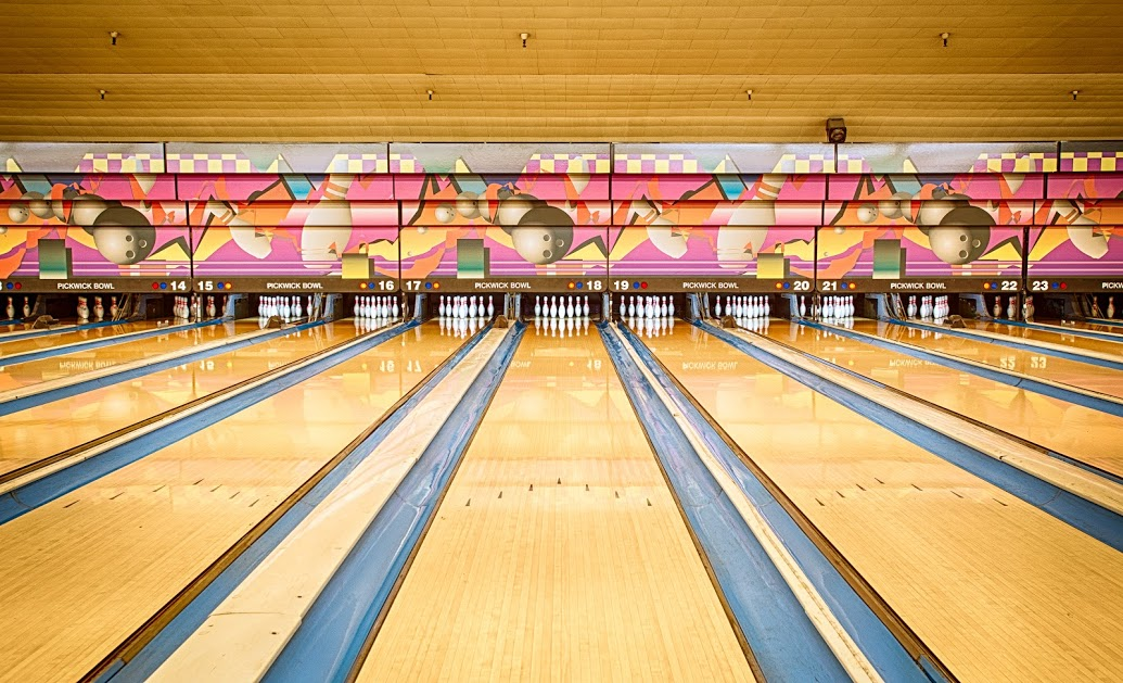 Bowling league bowling lanes with bowling pins all standing up